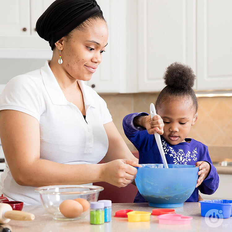 Girl with hearing loss helps mom bake in the kitchen